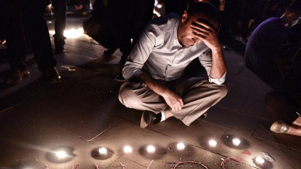 A man sits during a commemoration gathering for the Soma mine disaster victims in Istanbul, Turkey (AP)