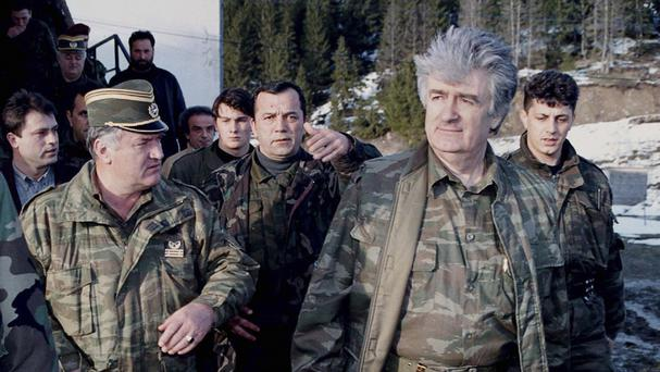Ratko Mladic, left, pictured with Bosnian Serb wartime leader Radovan Karadzic, right, in 1995 (AP)