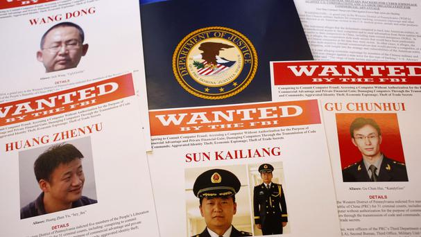 Wanted posters displayed at the US Justice Department after a grand jury charged five Chinese military staff with economic espionage and trade secret theft (AP)