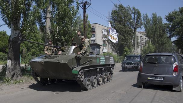 Pro-Russian militants in an armoured personal carrier guard streets in Slovyansk, eastern Ukraine. (AP Photo/Alexander Zemlianichenko, File)