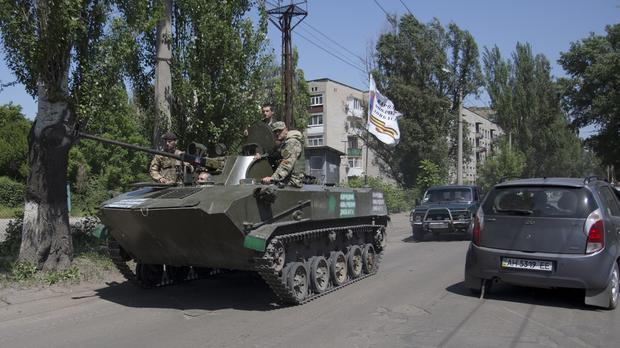 23882b0fae0 Pro-Russian militants in an armoured personal carrier guard streets in  Slovyansk