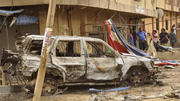 The scene of a car bomb blast in Kano, Nigeria, on Monday (AP)