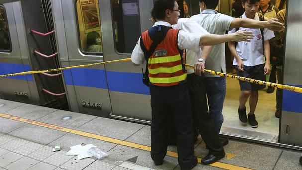 Officials block the scene of a knife attack on a subway platform in Taipei, Taiwan (AP)