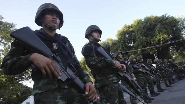 Thai soldiers stand guard near Government House in Bangkok, a day after their coup (AP)