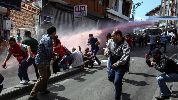 Riot police use water cannon and tear gas to disperse protesters in Istanbul, Turkey (AP)