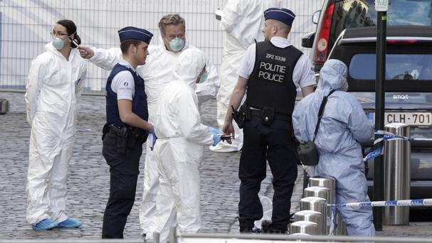Forensic experts examine the scene of a shooting at the Jewish Museum in Brussels (AP)