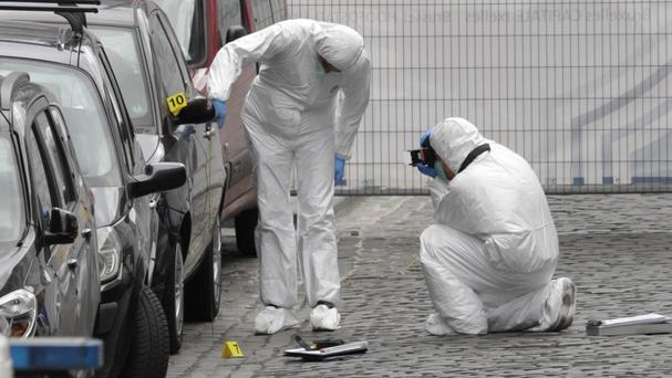 Forensic experts examine the site of the shooting at the Jewish Museum in Brussels (AP)