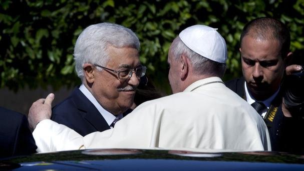 Palestinian president Mahmoud Abbas receives Pope Francis upon his arrival at the Palestinian Authority headquarters in the West Bank city of Bethlehem (AP)