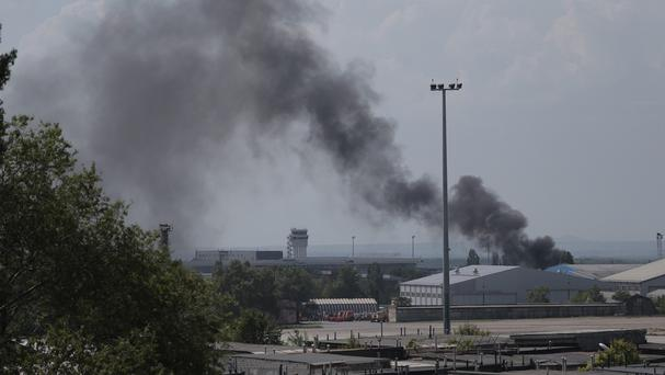 Smoke rises at the airport outside Donetsk, Ukraine. (AP)