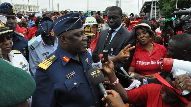 Air Marshal Alex Barde speaks during a demonstration calling on the government to rescue the kidnapped girls (AP)