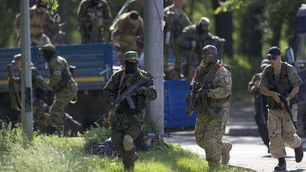 Pro-Russian insurgents near the airport outside Donetsk, Ukraine (AP)