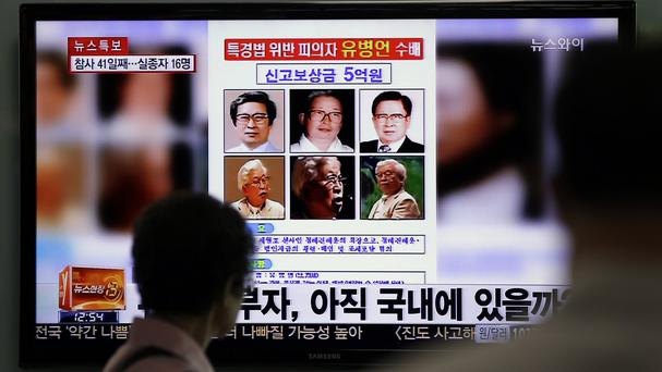South Korea is still hunting for Yoo Byung-eun who prosecutors say owned the ill-fated Sewol ferry (AP)
