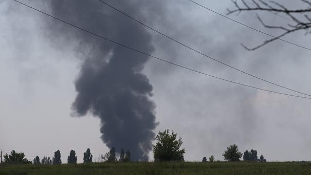 Black smoke rises from a shot down Ukrainian helicopter outside Slovyansk in Ukraine (AP Photo/Alexander Zemlianichenko)