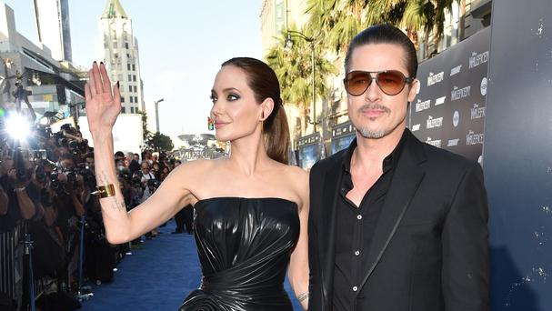 Angelina Jolie and Brad Pitt arrive at the world premiere of Maleficent (AP)