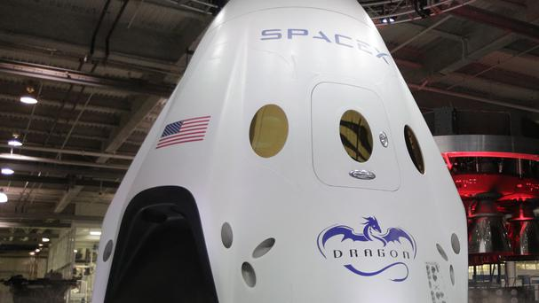 The SpaceX Dragon V2 spaceship is unveiled at its California headquarters (AP)