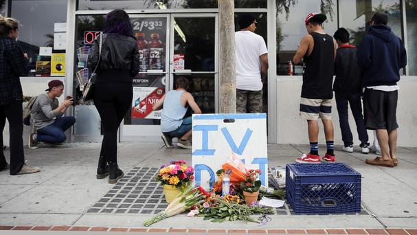 Flowers are left where part of the mass shooting took place (AP Photo/Jae C. Hong)