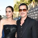 Angelina Jolie and Brad Pitt arrive at the premiere of Maleficent in Los Angeles (AP)