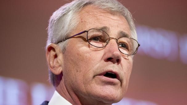 "Chuck Hagel warned the US ""will not look the other way"" when nations such as China ignore international rules and standards (AP)"