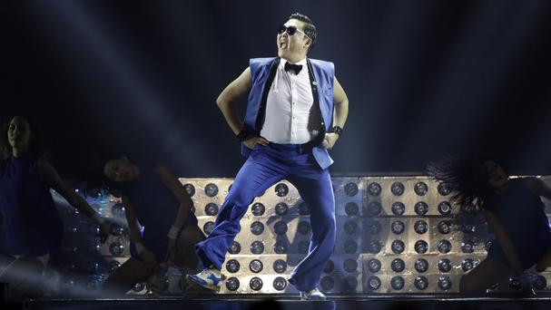 Psy has three of the top 15 videos on the YouTube site (AP)