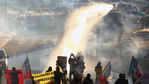 Police use water cannons and tear gas to disperse protesters on the first anniversary of last year's protests in Ankara, Turkey (AP)