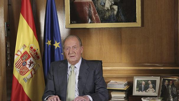 Spain's king Juan Carlos makes a televised speech announcing his abdication (AP/Spanish Royal Palace/EFE)