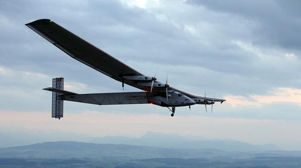 German test pilot Markus Scherdel steers the solar-powered Solar Impulse 2 aircraft during its maiden flight in Switzerland (AP)