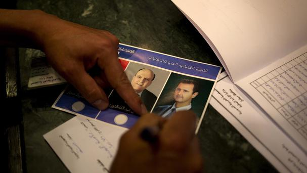 A man votes for President Bashar Assad in Damascus, Syria (AP)