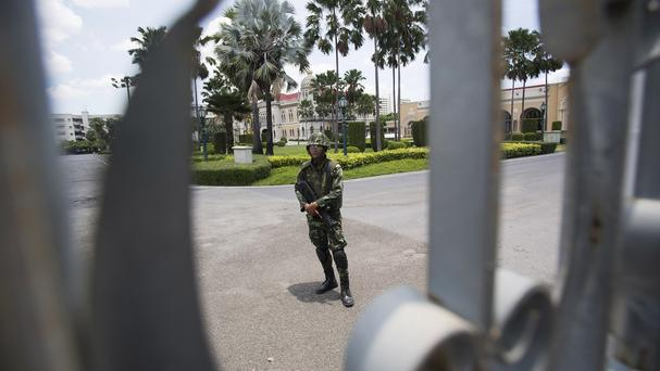 A soldier guard at the government house in Bangkok, Thailand (AP)