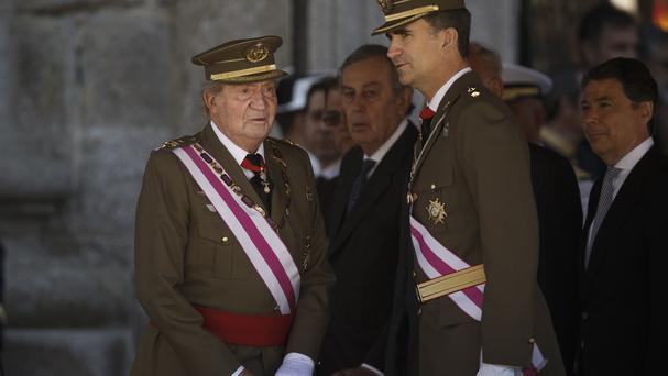 King Juan Carlos and Crown Prince Felipe attend a military ceremony in San Lorenzo de El Escorial, outside Madrid, Spain (AP)