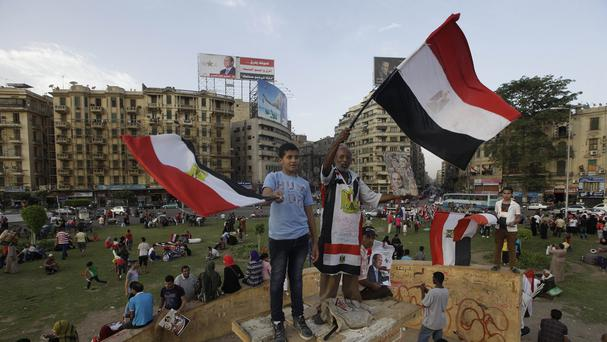 Egyptian supporters of Abdel-Fattah el-Sissi wave flags (AP)