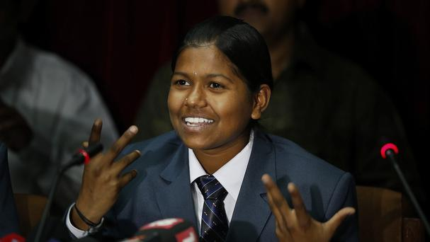 Malavath Poorna, from the southern Indian state of Andhra Pradesh, has become the youngest girl to climb Everest (AP)
