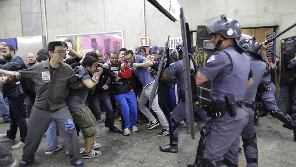 Subway train operators and some activists clash with police at the Ana Rosa metro station on the second day of their strike in Sao Paulo, Brazil (AP)