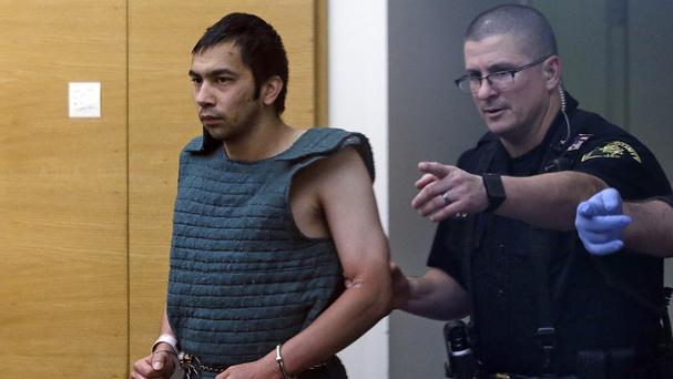 Shooting suspect Aaron Ybarra is taken into a hearing at King County Jail courtroom in Seattle (AP)