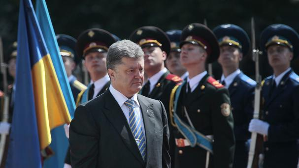 Ukrainian President Petro Poroshenko reviews an honour guard after his inauguration ceremony in Kiev (AP)