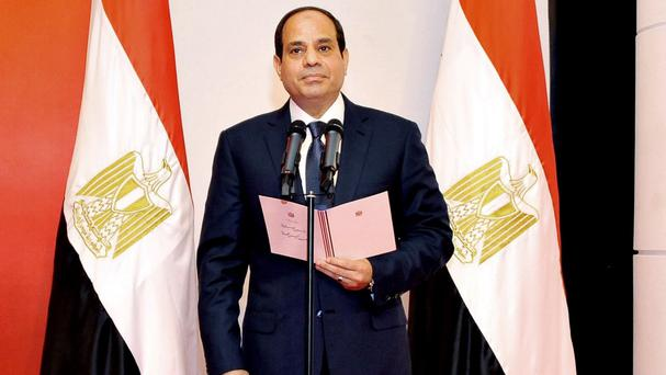 The newly sworn-in President Abdel-Fattah el-Sissi takes his oath at the Supreme Constitutional Court in Cairo, Egypt (Middle East State News Agency/AP)