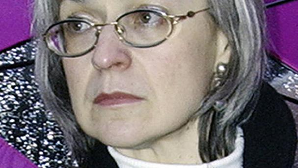 A Russian court has sentenced two men to life in prison and three others to terms ranging from 12 to 20 years for the 2006 killing of renowned journalist Anna Politkovskaya (AP)