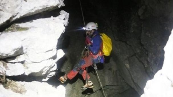 A rescuer enters the cave near Berchtesgaden, Germany (AP)
