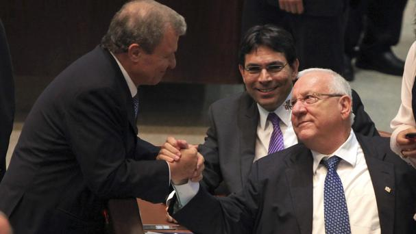 Reuven Rivlin shakes hands with beaten rival Meir Sheetrit during Israel's presidential election (AP)
