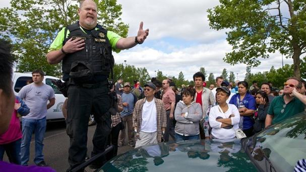 Police instruct family members on where to pick up students after a shooting at Reynolds High School in Troutdale, Oregon (AP/The Oregonian, Thomas Boyd)