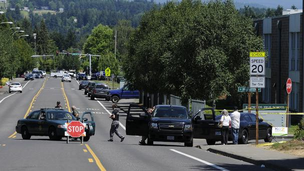 Officials closed the roads to the scene of a shooting at Reynolds High School in Troutdale, Oregon (AP)