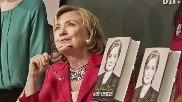 HiIlary Clinton listens before signing a copy of her book at Barnes and Noble in New York (AP)