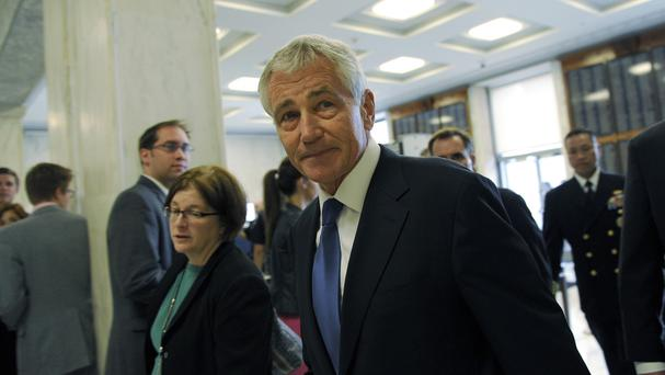 US defence secretary Chuck Hagel arrives on Capitol Hill in Washington to testify before the House Armed Services Committee. (AP Photo/Susan Walsh)