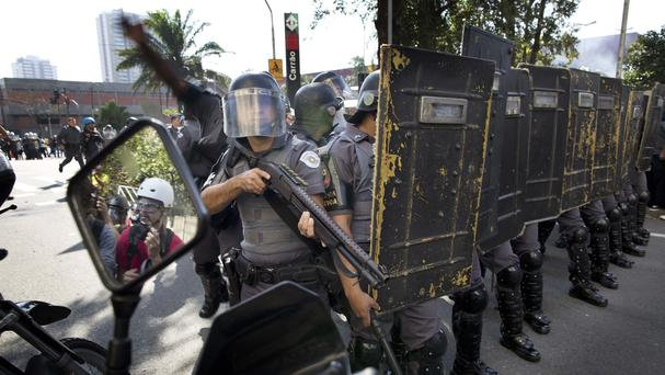 Police in Brazil prepare to advance on a demonstration by people protesting over the money spent on the World Cup (AP)