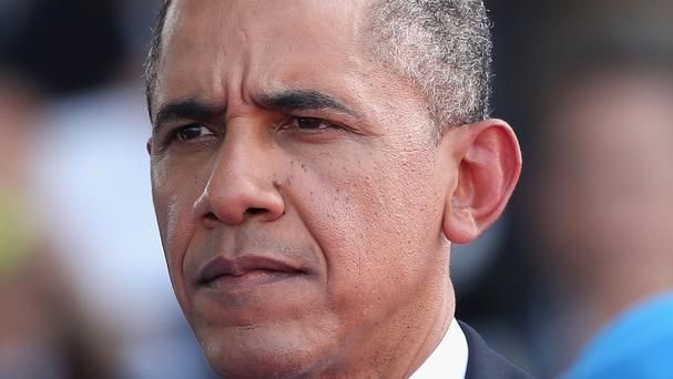 Barack Obama has ruled out putting soldiers on the ground in Iraq for now