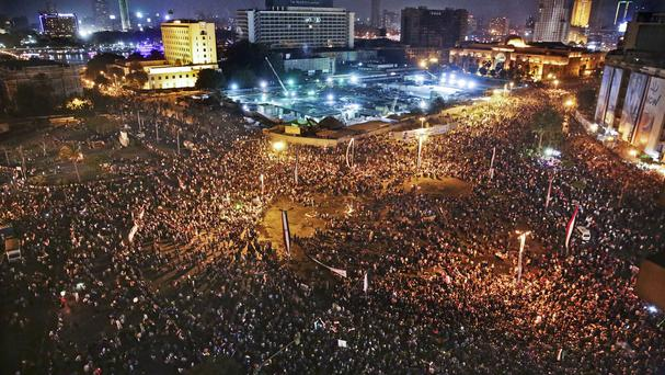 Supporters of Egyptian president Abdel-Fattah el-Sissi celebrate his inauguration in Tahrir Square (AP)