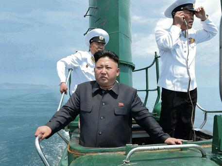 North Korean leader Kim Jong-un proudly inspects the KPA Naval Unit, offering navigation tips and stern battle orders to the submarine's captain. Reuters/KCNA.