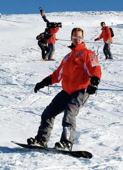 Formula One ex-champion Schumacher, who sustained severe head injuries in a ski accident in late 2013, is no longer in a coma and has left the French hospital where he was being treated since the accident, his spokeswoman said on June 16, 2014. REUTERS/Ercole