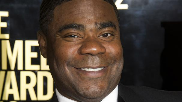Actor and comedian Tracy Morgan is improving following a highway crash that killed one of his friends (AP)