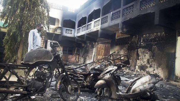 The remains of vehicles and buildings in the Kenyan town of Mpeketoni after an attack by Somali extremists (AP Photo)