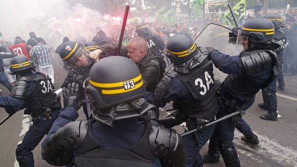 French riot police clash with striking train workers in Paris (AP)
